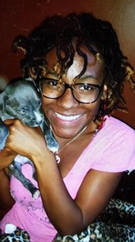 Carlesha Freeland-Gaither and puppy. Photo from: www.nydailynews.com